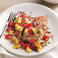 Baked chicken accented with crispy coconut and fresh mango salsa makes a tasty summer entree.