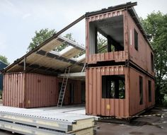 Three shipping containers with a common area between