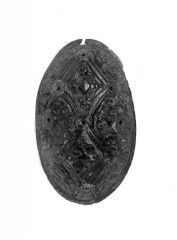This brass oval brooch was found in a burial from the Viking age cemetery at Pierowall on Westray in Orkney.