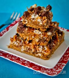 Salty Sweet Seven Layer Bars by Love From The Oven using pretzels and caramel!