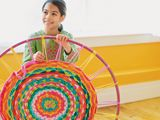 Weave round rug on hula hoop using t-shirts