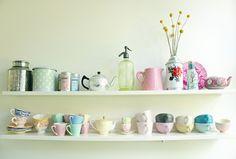 Rustic Tea Cup Display vintage teacups, pastel, vintage kitchenware, kitchen shelves, decorating kitchen, color, wall shelving, kitchen interior, kitchen designs
