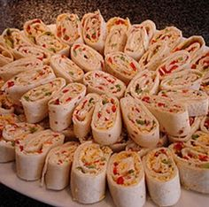 Tortilla Pinwheel Appetizers 10 large flour tortillas 1 cup chopped veggies – I like using red and green peppers, red onion, and celery. 1.5 blocks cream cheese, softened 1 package dry ranch dressing mix 1/4 cup salsa 1/2 cup shredded cheddar cheese