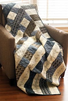 4-inch strips, 4-inch squares, 4-inch ... you get the idea-the power of 4 is strong in designer Tony Jacobsons straight-line quilt. Bands of blue are woven together with sand and sea color strips, creating a cohesive end result.
