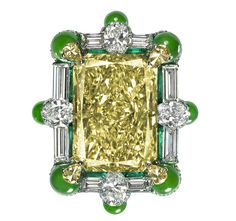 The Grandeur ring by Wallace Chan. Note how there is not metal visible thanks to Chan's innovative settings that abutt the stones to each other and hold them in place. The 19 ct yellow diamond is surrounded by rods of emerald, white diamonds and jadeite. The ring echoes traditional Chinese architecture with three distinctive characteristics: upturned eaves, brackets and ornaments