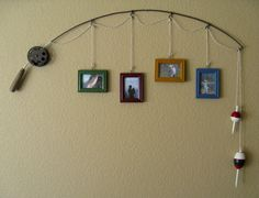 recycled fishing pole for boys room.