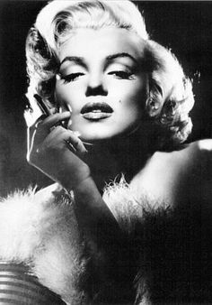 I wouldn't hate looking like her, this is the old Hollywood feel I want. Glamorous and beautiful