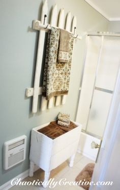 I like this idea for a towel bar! I'm not sure I'd distress it because it might not match the bathroom, but with a clean, white, polished finish, it could work!