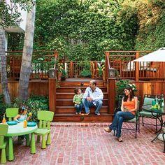family on rebuilt backyard deck with brick patio