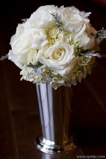 bouquets with hydrangea, roses, dusty miller, lisianthus, and ranunculus.