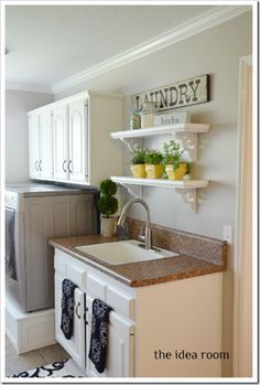 laundry room painted cabinets--really like the look and function of this laundry. They built most all of the storage, and the post has several links. jb Wall color benjmoore revere pewter.