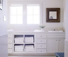 Double windows between double sink vanity