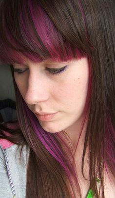 Purple streaks in hair.