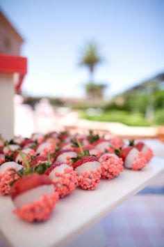 Strawberries dipped in white chocolate and pink nerds