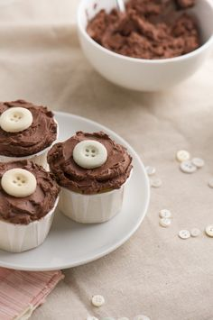 world's best vanilla cupcakes with milk chocolate ganache frosting and a sugar button on top!