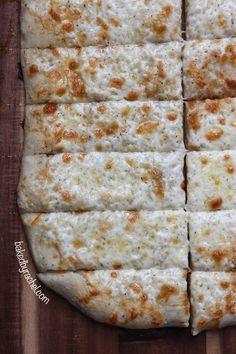 Cheesy Garlic Pizza Bread Sticks Recipe from bakedbyrachel.com