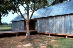DOGTROT ◆Stephen Atkinson Architecture. Shutters cover windows.