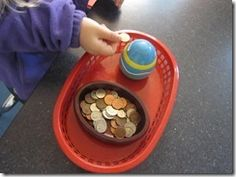 Coins in a piggy bank, fine motor skills
