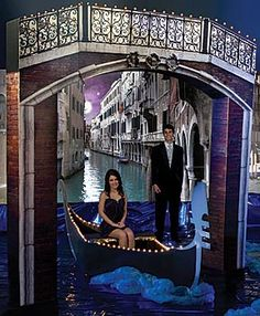 Accent your Venetian themed Prom with this cardboard Venetian Sky Arch. The 9 ft. 8 in. high x 11 ft. wide printed Venetian Sky Arch is accented with twinkle lights.
