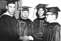 #lookingback Genesee Community College held its first commencement ceremony in the spring of 1969. Pictured on left is Dr. Stuart Steiner with three members of the first graduating class.