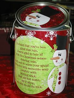 Family size Snowman Soup in a Can for friends and neighbors, it includes:hot cocoa mix, marshmallows, candy canes, Hershey kisses ~ Poem on Can: Heard that you've been good this year. Always glad to hear it! With chilly weather drawing near, You'll need to warm your spirit. So here's a little snowman soup, Complete with stirring stick. Just add hot water and sip it slow, It's sure to do the trick!