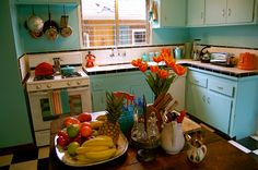 Turquoise + Orange Kitchen...Black and White Tiled Counter