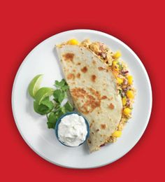 3 Tbsp brown mustard, 2 Tbsp honey, 3 tsp hot sauce,1 tsp salt,1 rotisserie chicken (meat removed and shredded), 1 cup shredded mozz,1 small red onion (chopped finely), ½ bunch cilantro (finely chopped), 1 ripe mango (peeled & finely chopped), 8 10-inch flour tortillas. Mix first 4 ingredients with chicken. Heat a pan, spray with non-stick spray. Warm flour tortilla. Spread cup of cheese. Add half of the tortilla some chicken, onions, cilantro, and mango. Fold over tortilla & melt cheese.