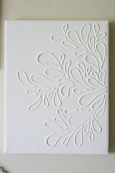 Trace a pattern on wax paper with puffy paint, peel off and stick to a canvas with mod podge.