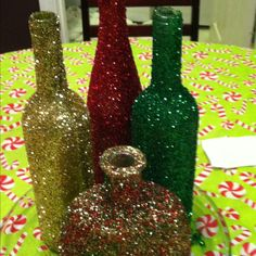 Glitter covered wine bottles, pretty to decorate for christmas :)