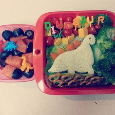 PB&J dinosaur sandwich with pepper spikes, broccoli (it's a brachiasaurus' favorite food!), pretzels, tomatoes, cheddar cheese, watermelon, and grapes. Bento for kids. Creative lunchbox ideas.