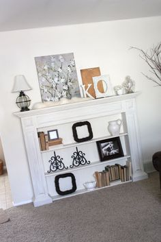 Love this faux mantle - great way to incorporate storage space with shelves, could easily mount tv above AND use the mantle to hide wires