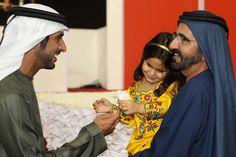 Dubai — Her Highness Sheikha Al-Jalila bint Mohammed Al Maktoum in the arms of her father His Highness Sheikh Mohammed bin Rashid Al Maktoum, Dubai ruler, and her brother His Highness Sheikh Hamdan bin Mohammed bin Rashid Al Maktoum, the crown prince of Dubai. ♥ REPIN, LIKE, COMMENT & SHARE! ♥