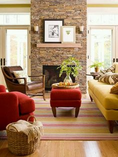 living rooms, rug, red, color schemes, chairs, live room, fireplace wall, bold colors, stone fireplaces