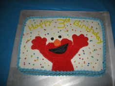 I made this cake for my son's 3rd birthday.  Its a 9x13 cake and for elmo i printed a coloring page off the computer and traced it on wax paper. I then frosted the cake w/ buttercream frosting and set the elmo template on the cake and traced around it w/ a toothpick then outlined elmo w/ a small tip and star tipped him.  To finish just put a border around the top and bottom and add some bright colored sprinkles.  he loved his elmo cake!!