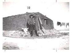 ... Early Settlers - ca. 1890-1940 - Norwegian Settler Outside Sod House