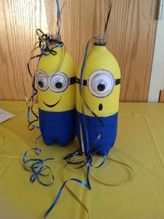 Despicable me party using recycled 2liter soda bottles. Perfect center pieces or ballon holders if filled with rice or dry beans.