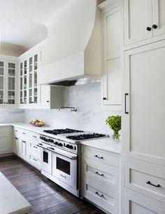 white cabinets - carrera marble - dark wood floors - stainless