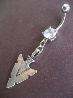 Arrowhead- Belly Button Jewelry Ring Tribal Native American Arrow Head Charm Dangle Navel Piercing. $12.50, via Etsy.