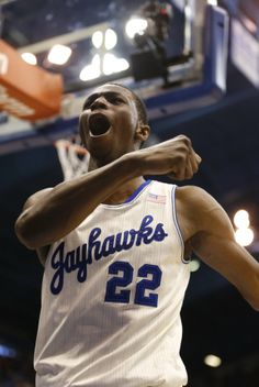 Kansas guard Andrew Wiggins celebrates after delivering on a breakaway dunk against Kansas State during the second half on Saturday, Jan. 11, 2014 at Allen Fieldhouse. #KU