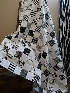 Black and white quilts on pinterest pinwheel quilt for Black white and gray quilt patterns