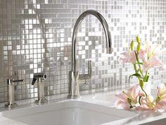 Stainless Tile backsplash.    Source: choicegranite on Flickr