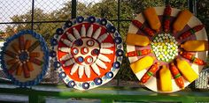 Recycled water bottle and bottle cap art.  Really cool to use as outdoor art for school playground.