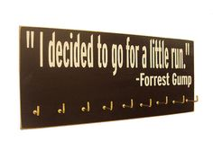running medals display Forrest Gump by runningonthewall on Etsy {Looks like I found what I want to do with all my race medals.} Race Bib, Fit, Craft, Inspiring Quotes, Forrest Gump, Stuff, Running Bib Display, Medal Holder, Medal Display