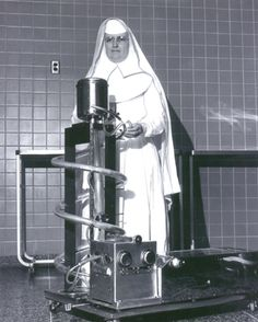This Sister of #Mercy is standing proudly with a cutting-edge piece of medical equipment in the 1960s. The heart-lung machine keeps oxygenated blood circulating during surgery. #throwbackthursday #tbt