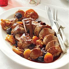 "Roasted Pork with Dried Fruit and Port Sauce | ""Prepare the meat and sauce separately,"" Victoria says, ""and then warm them together just before the guests arrive."" 