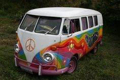 My first car was a 66 VW bus like this - without the cool paint job