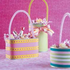 Eco-Friendly Easter Baskets  Recycle cans and tins to make charming little candy baskets for Easter. Cover containers with paper and embellish with colorful ribbon. Use chenille stems as decorative handles.