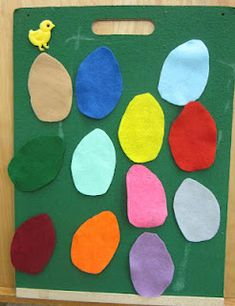 The children have been really enjoying felt games   where an item is hidden   and they have to guess which coloured item it is hiding behind