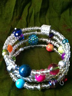 "Idea for colorful beads ""floating"" between clear (or neutral) beads - SarahsGypsyWagon on Etsy     Unique Memory Wire bracelet Fun colors jewelry"