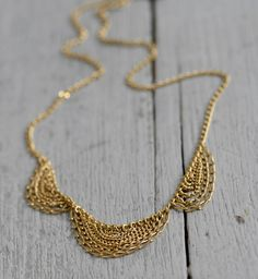 Gold Scallop Necklace by Kate Wood Jewelry, £190 Buy here  http://www.shoptent.co.uk/products/gold-scallop-necklace